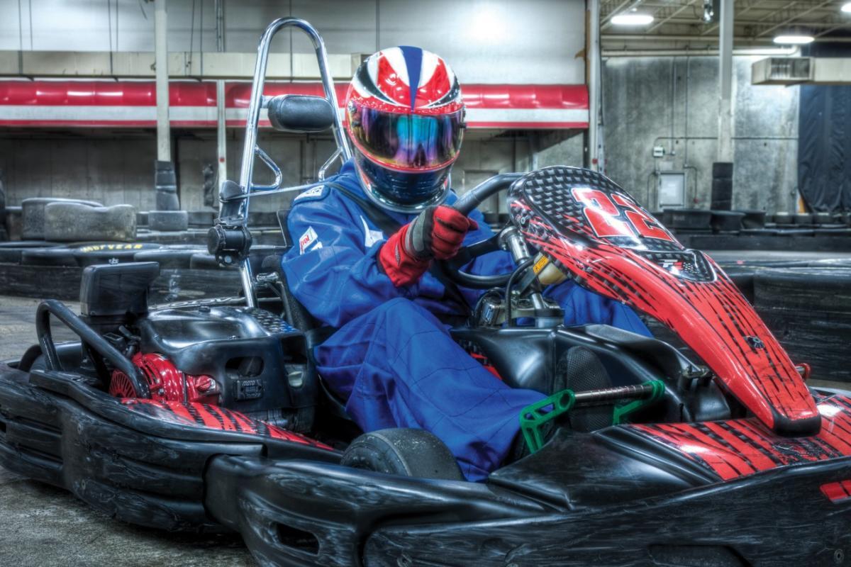 Teens racing karts at Octane Raceway